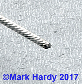 Gear cable showing spirally wound strands and spot welded end.